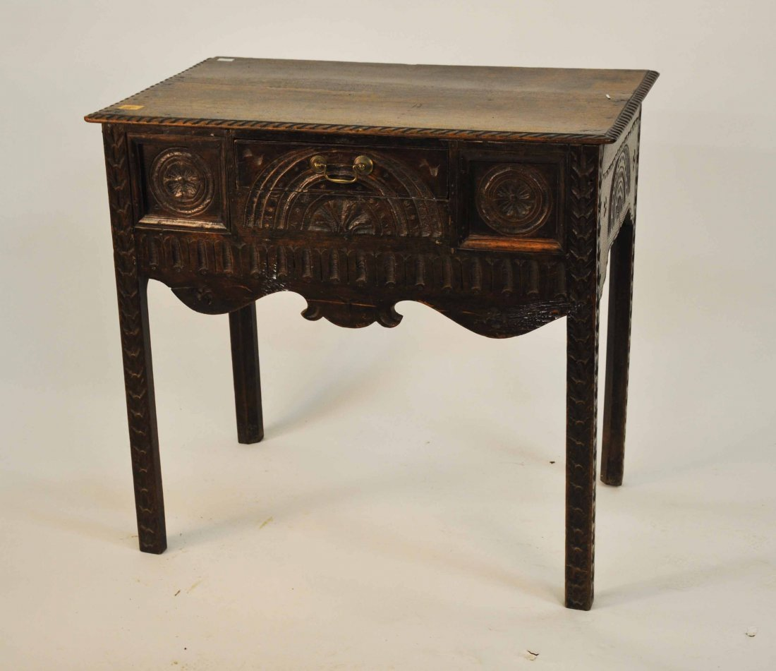 609: An oak low boy or side table, in the 18th century