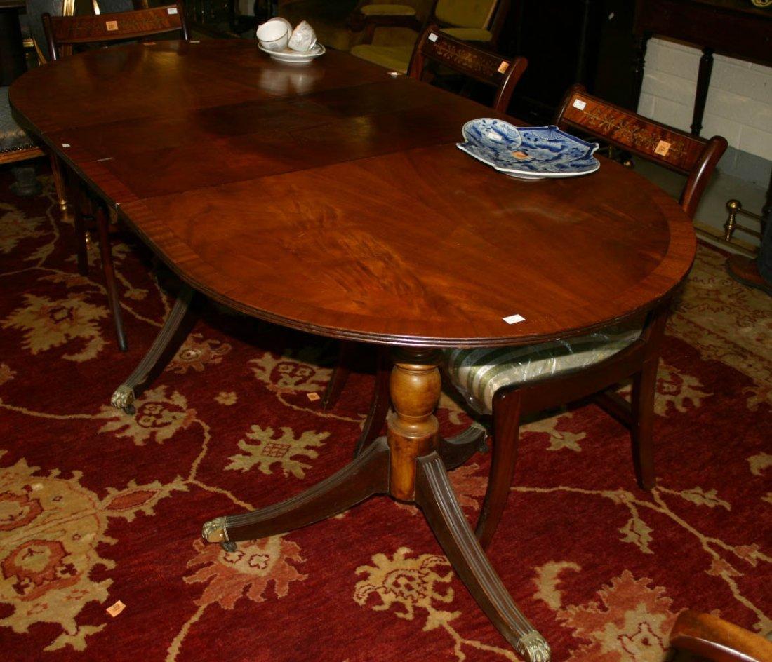611: A mahogany and cross banded dining table, modern i