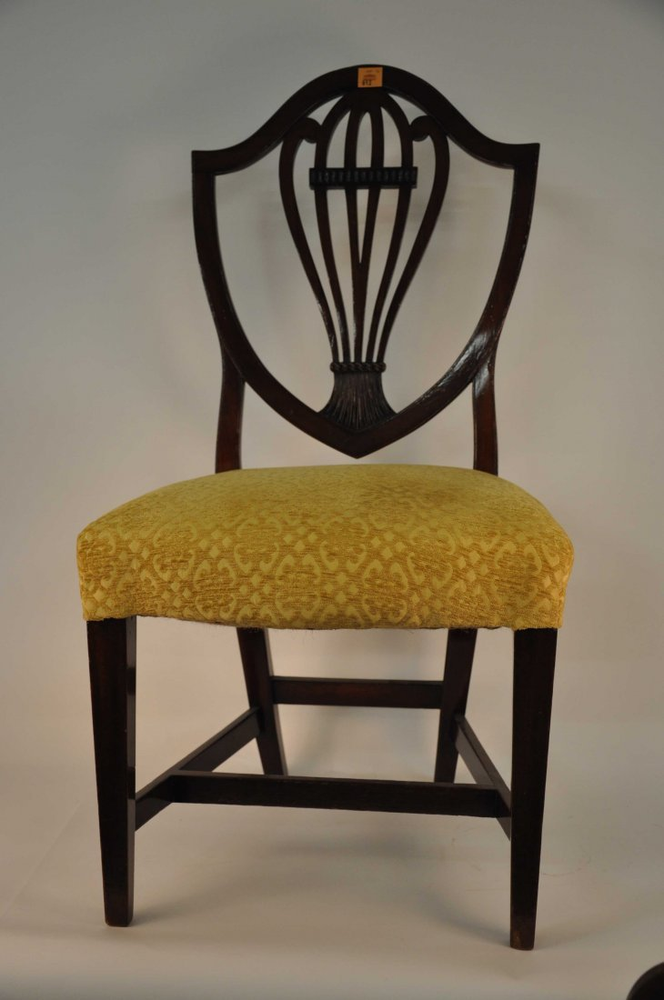 612: A set of six mahogany dining chairs, George III st