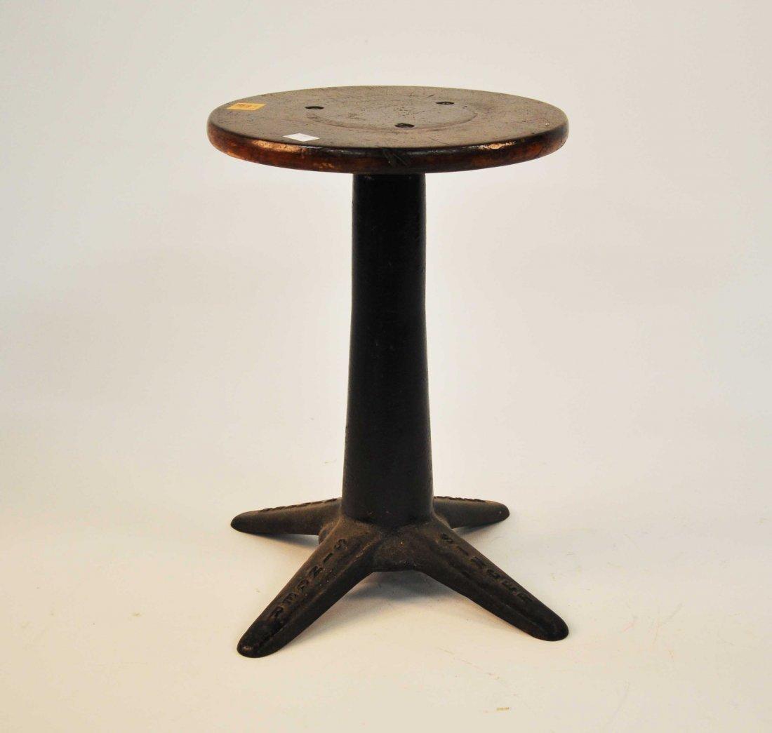 621: A circular  singer  sewing machine stool; together