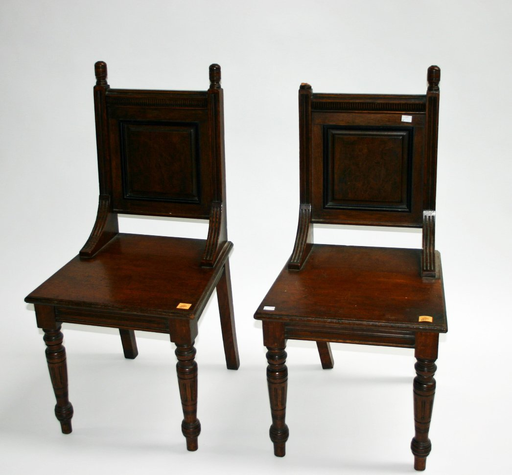 627: A pair of walnut hall chairs, Edwardian, each with