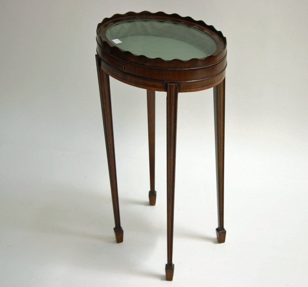 629: An unusual oval mahogany curio display table, in t
