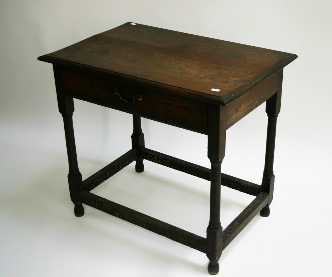 632: An oak side table, in the 18th century style, the