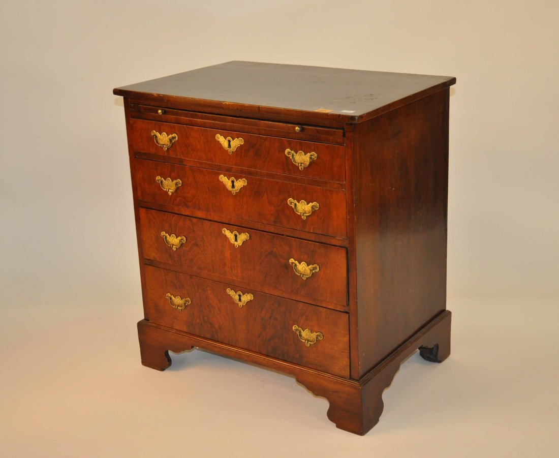 877: A small walnut chest, in the 18th century style,