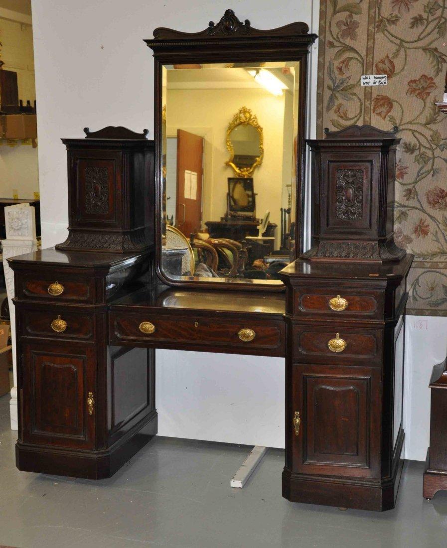 885: A walnut pedestal dressing table,  Edwardian, the