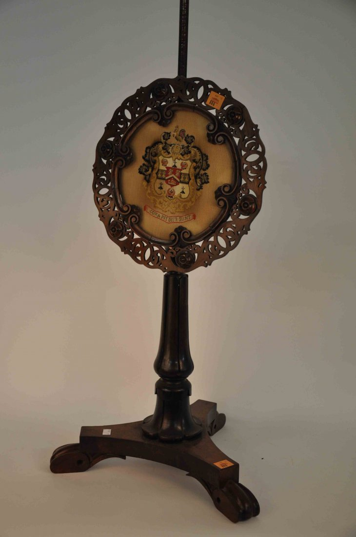 888: A Victorian rosewood polescreen,  with needlework