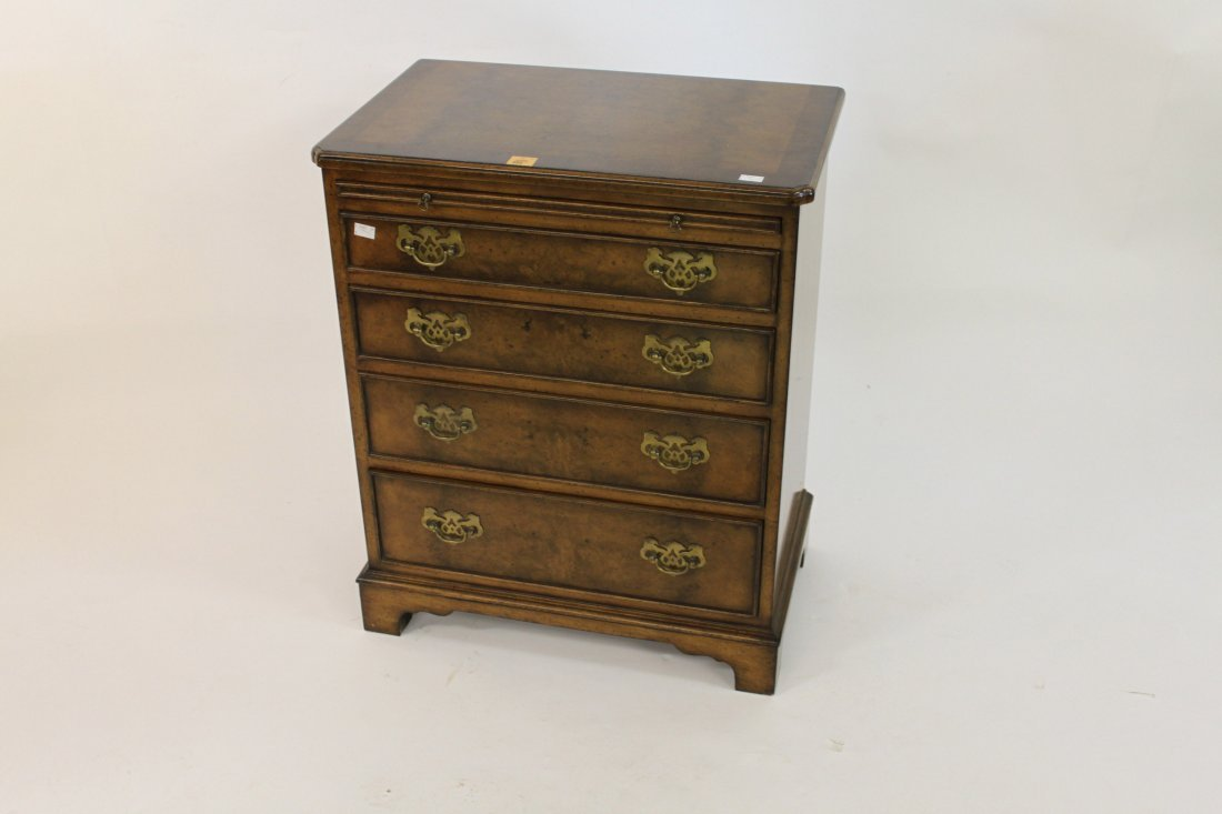 889: A walnut and cross banded chest, of small proporti