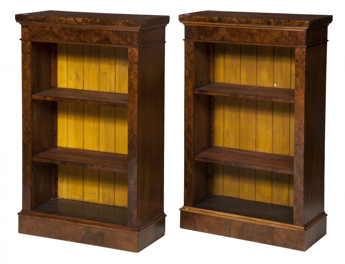 891: A pair of figured walnut open bookcases, each with
