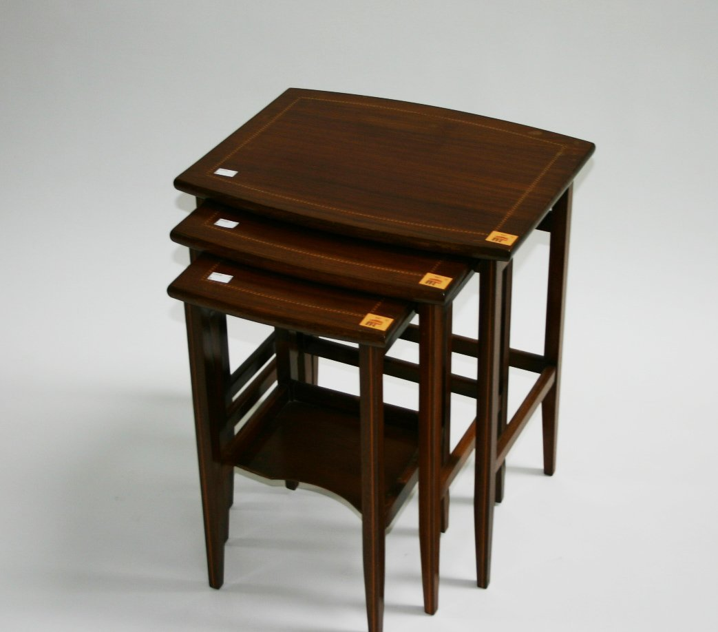 894: A nest of three inlaid mahogany bow fronted Occasi