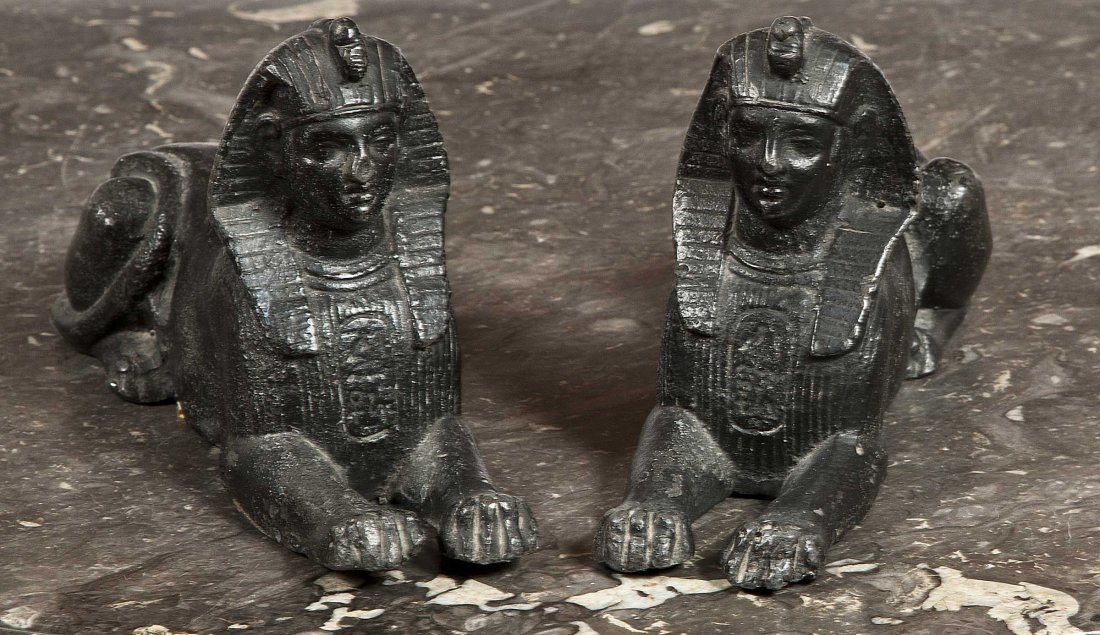 3: A pair of black-painted lead models of Egyptian Sphi
