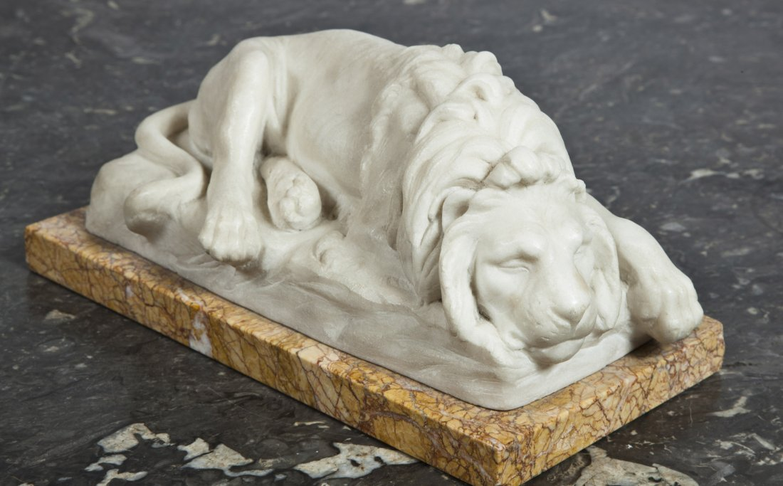 10: A white marble model of a sleeping Lion,