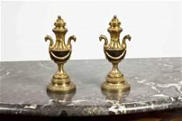 13 A pair of Louis XVI ormolu and patinated bronze Cas