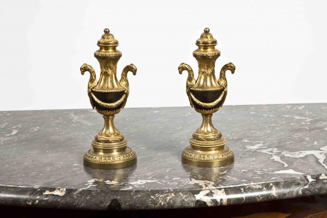 13: A pair of Louis XVI ormolu and patinated bronze Cas