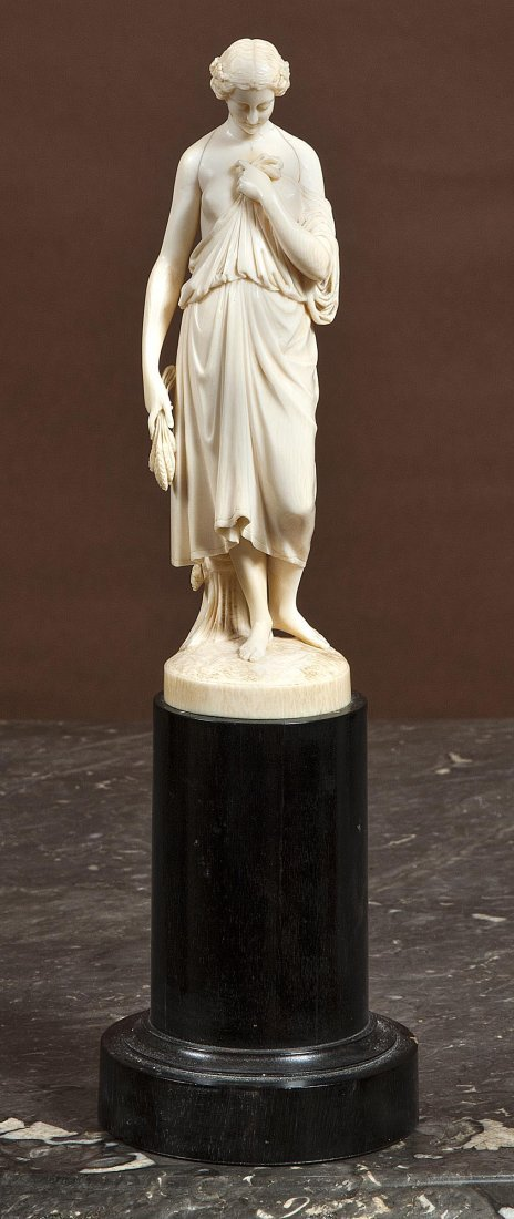 14: A 19th Century ivory figure of Ceres,