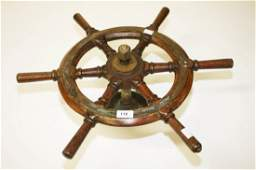 A BRASS MOUNTED SHIPS STEERING WHEEL with turned oak