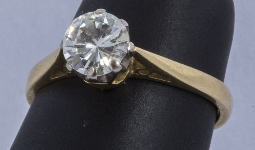A FINE LARGE DIAMOND SOLITAIRE RING, the oval diamond