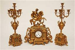 AN ATTRACTIVE THREE PIECE FRENCH GILT METAL AND ONYX