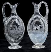 A VERY RARE PAIR OF ACID ENGRAVED GLASS CLARET JUGS,
