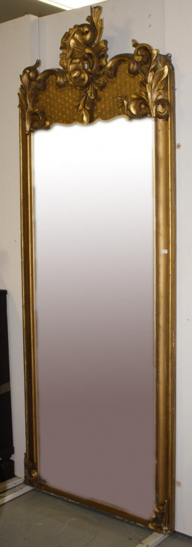 A GILT ASYMMETRICAL PIER MIRROR,  19th century, with