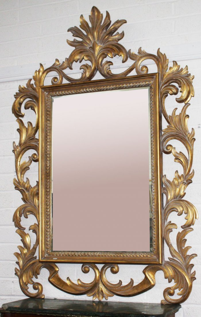 A LARGE CARVED GILT WALL MIRROR in the late 18th