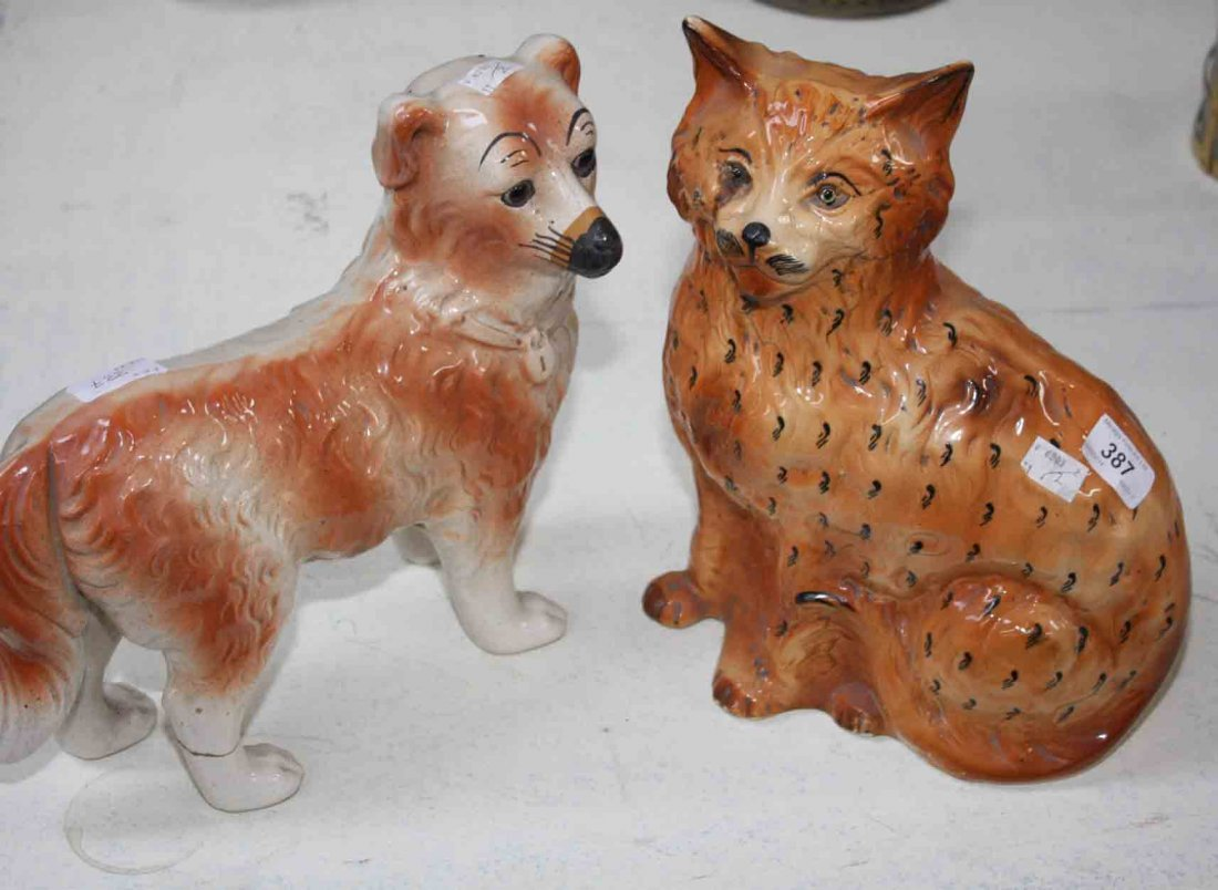 OLD STAFFORDSHIRE FIGURES OF DOG AND CAT the cat seated