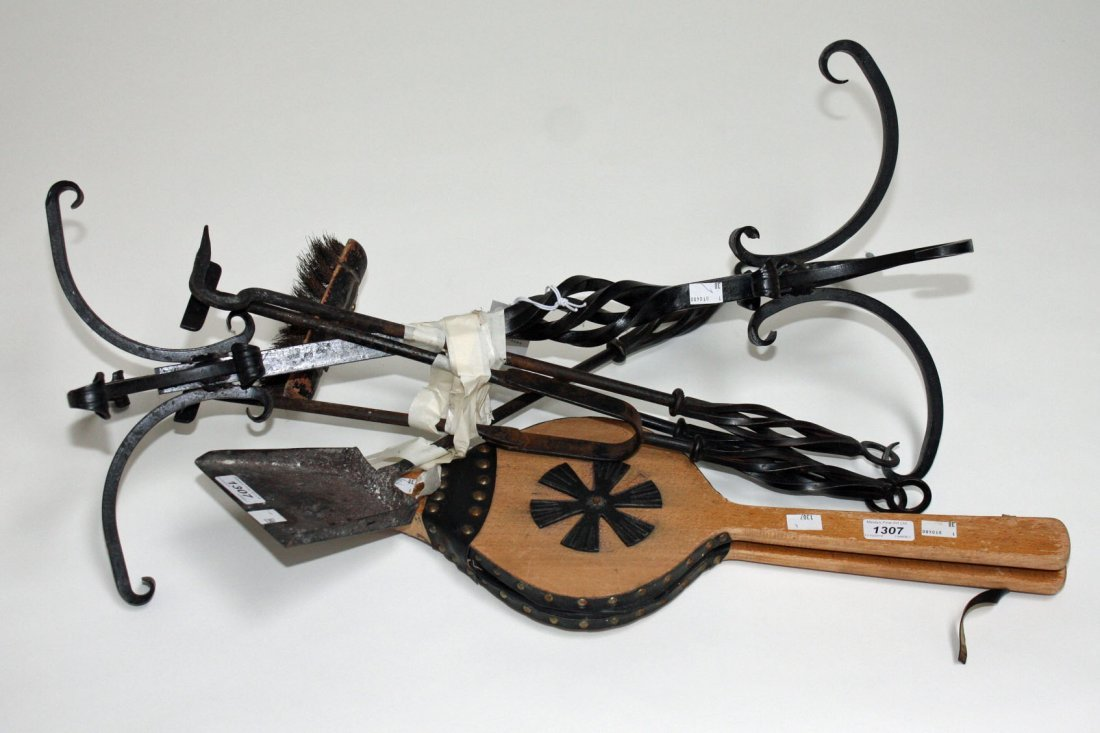 A WROUGHT IRON FIRE TIDY and bellows. (2)