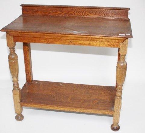 AN OAK SIDE TABLE WITH STRETCHER SHELF, on turned