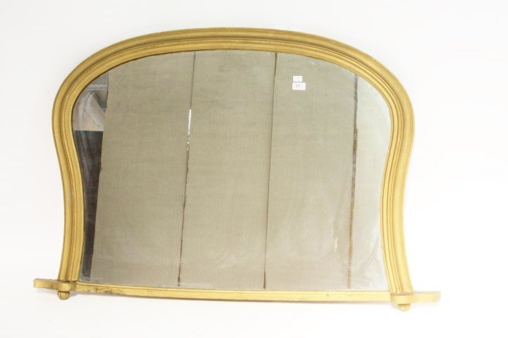 A 19TH CENTURY GILT OVERMANTEL,  with arched top in a