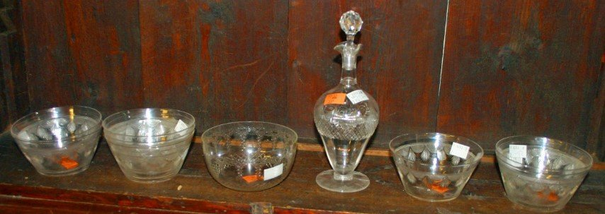 A SMALL LIQUOR DECANTER and stopper and a set of eight