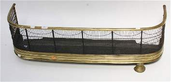 A 19TH CENTURY BRASS FENDER,  with tubular top rail and