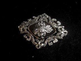 7: Nice brooch