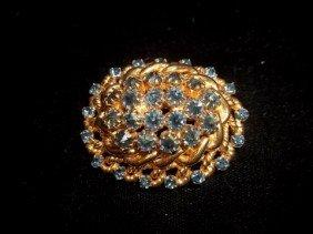 8: Nice blue rhinestone brooch