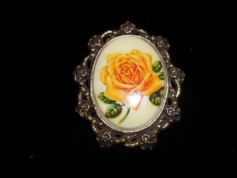 9: Nice flower portrait brooch