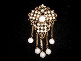 17: White rhinestone brooch