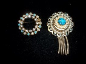 22: 2 Blue ice brooches