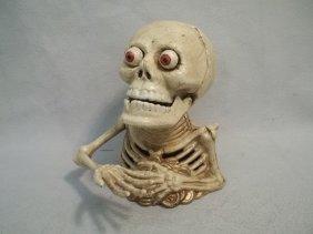 Cast Iron Bugging Eyes Skeleton Bank