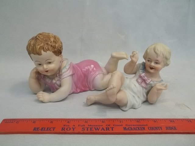 2 Porcelain baby Figures