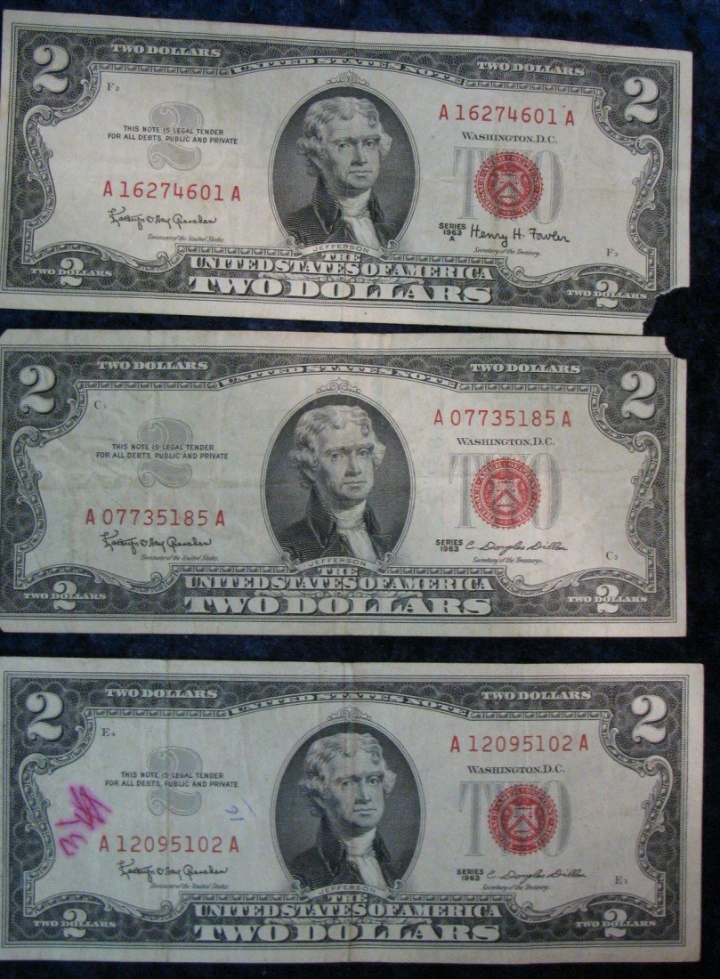 20. (2) 1963 & 63A U.S. One Dollar notes with red seals