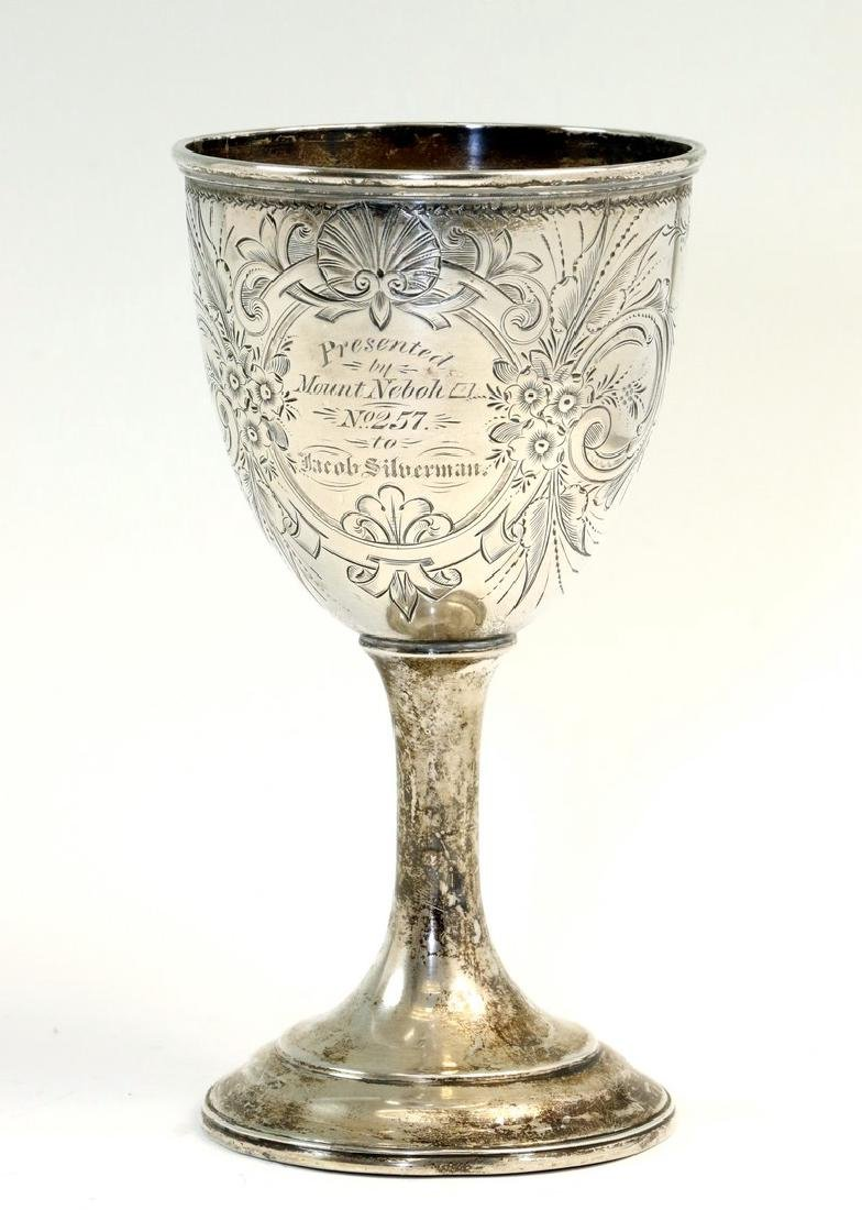 A LARGE COIN SILVER KIDDUSH GOBLET. American, c. 1860.