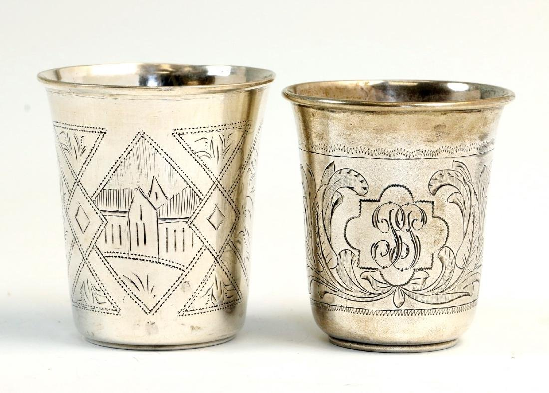 TWO LARGE SILVER KIDDUSH BEAKERS. Russian, 1876 and c.