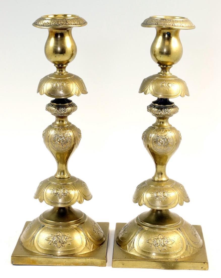 A PAIR OF BRASS SABBATH CANDLESTICKS BY NORBLIN.
