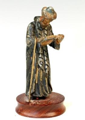 A CAST SCULPTURE OF A JEWISH MAN PRAYING. Continental,