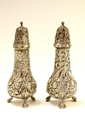 A SILVER SALT AND PEPPER SHAKER . American, c. 1890.