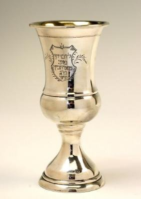 A LARGE SILVER KIDDUSH GOBLET. Poland, 1926. In