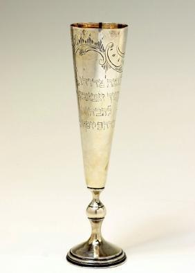 A SILVER KIDDUSH CUP. Russian, 1932. In flute shape.
