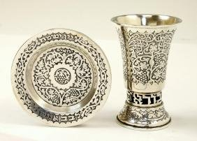 A STERLING SILVER BECHER AND UNDERPLATE BY BEZALEL.
