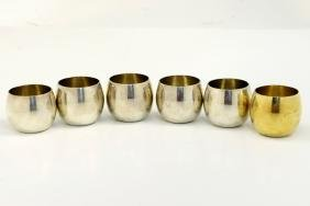 A SET OF SIX STERLING SILVER SHOT CUPS BY TIFFANY. New