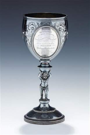 A MONUMENTAL PRESENTATION CUP BY WOOD AND HUGHES. New