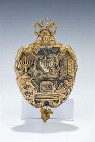 A LARGE GILDED SILVER AMULET. Italian, 20th century. In