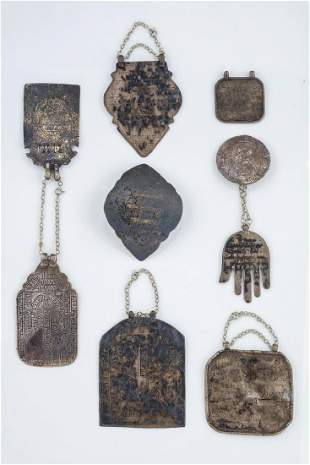 A GROUP OF EIGHT SILVER AMULETS. Middle Eastern,